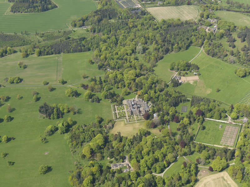 General oblique aerial view centred on the country house with the policies and gardens adjacent, taken from the  S.