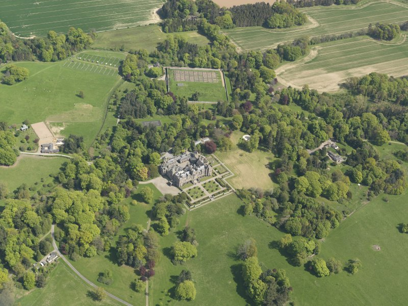 General oblique aerial view centred on the country house with the policies and gardens adjacent, taken from the  NW.