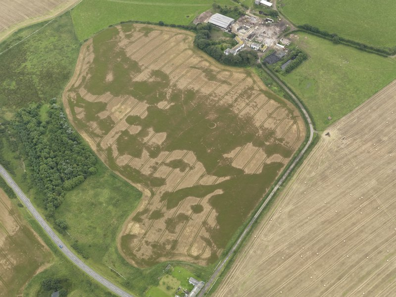 Oblique aerial view of the cropmarks of the pit defined avenue and cursus and the barrow at Kirkmabreck, taken from the N.