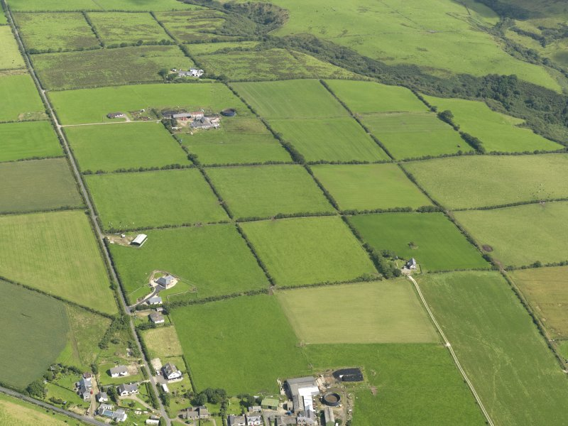 General oblique aerial view of the square patchwork field pattern, taken from the SW.