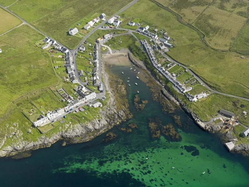 Oblique aerial view centred on the vilage of Portnahaven, taken from the SW.