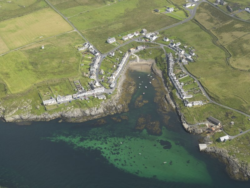 Oblique aerial view centred on the vilage of Portnahaven, taken from the SSW.