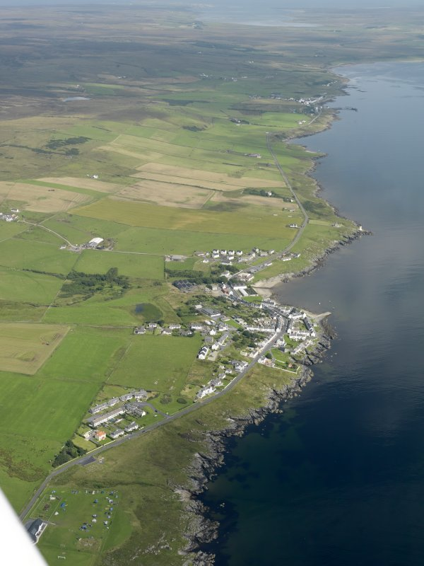 General oblique aerial view looking along the E coast of the Rinns of Islay with Port Charlotte in the centre, taken from the SSW.