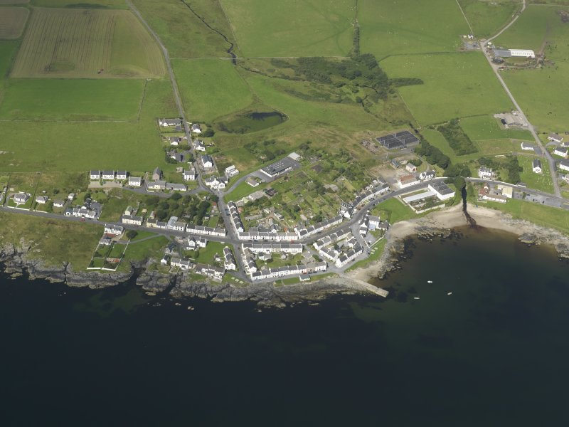 Oblique aerial view of the village of Port Charlotte, taken from the ESE.