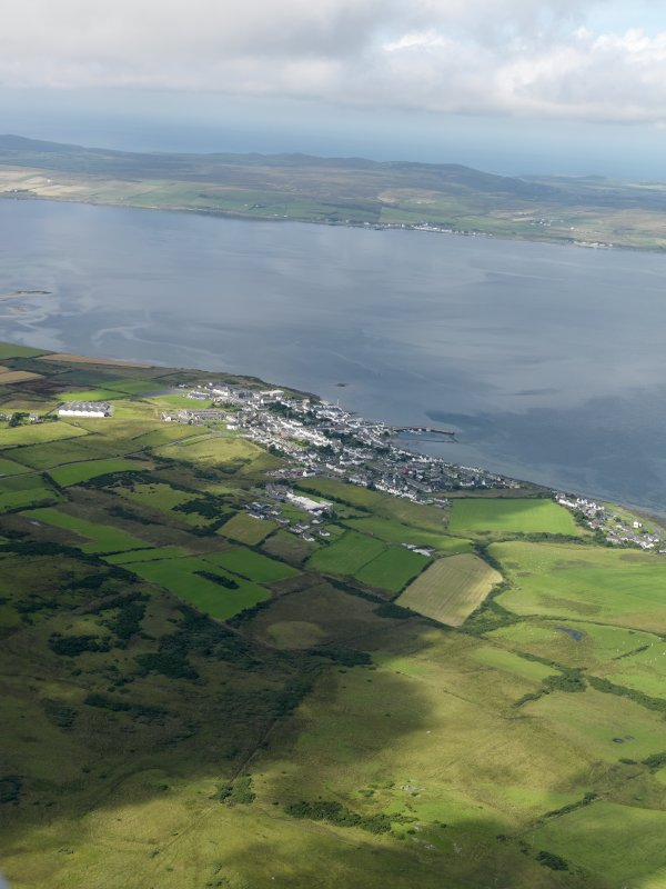 General oblique aerial view of Bowmore village, Islay with Loch Inndal beyond, taken from the SE.