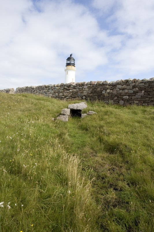 View of culvert beneath wall to the NW of the lighthouse.