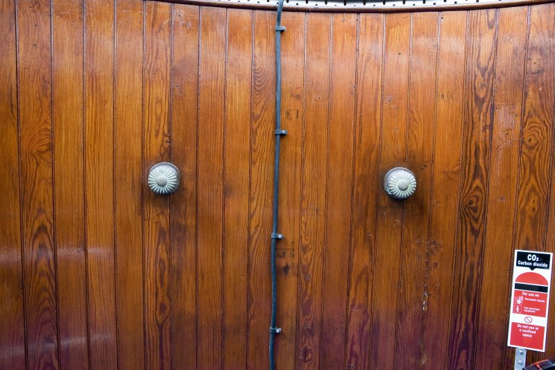 Detail of wood-panelled doors of cupboard in lighthouse tower.