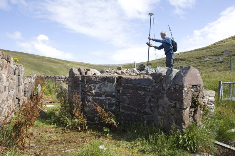 Kearvaig, farmstead, Mr I Parker (RCAHMS) surveying walling to S of range.
