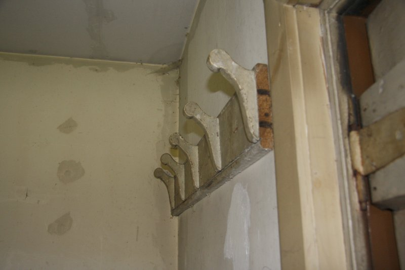 Kearvaig, shepherd's house, detail of wooden coat-pegs in back room.