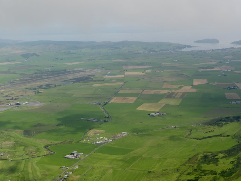 General oblique aerial view looking towards Campeltown in the distance, taken from the W.