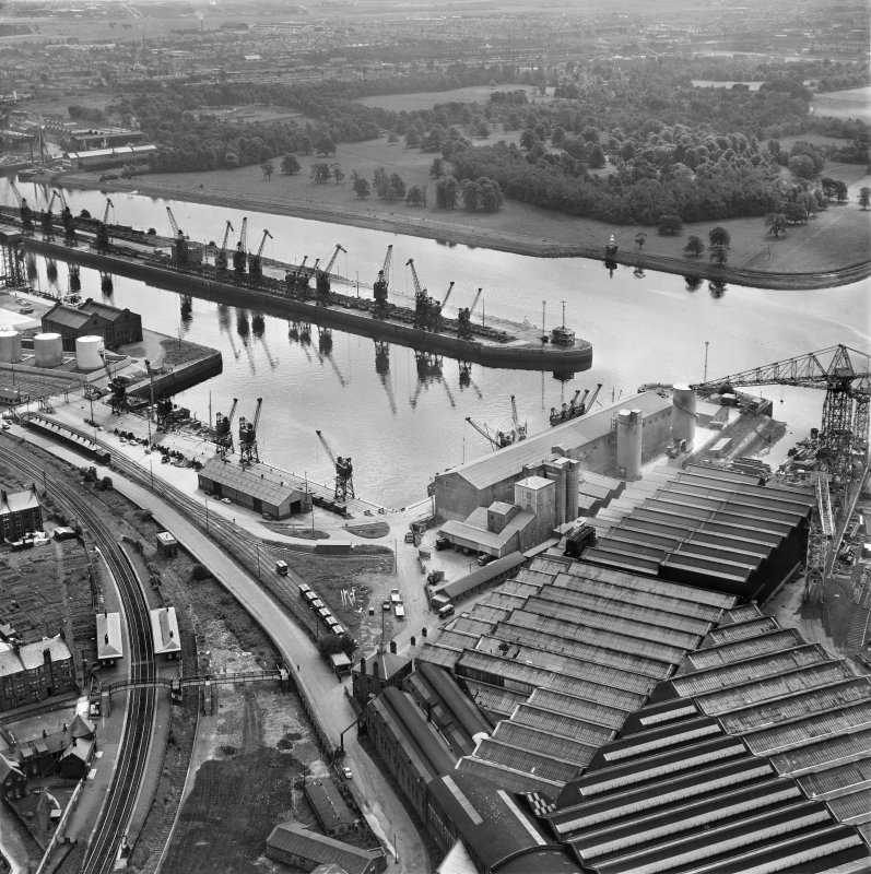 Glasgow, Clydebank, oblique aerial view centred on part of John Brown's shipyard with Clydebank Riverside Station adjacent, taken from the NW.