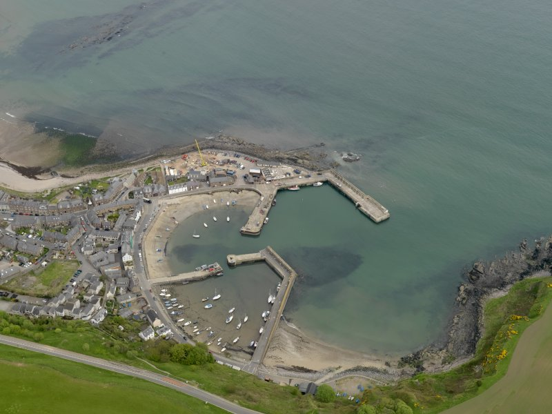 Oblique aerial view centred on the harbour with the Shorehead adjacent, taken from the SW.