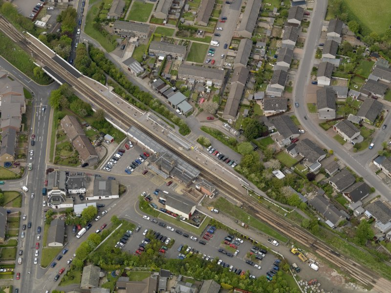 Oblique aerial view centred on the railway station with the Station Hotel adjacent, taken from the NE.
