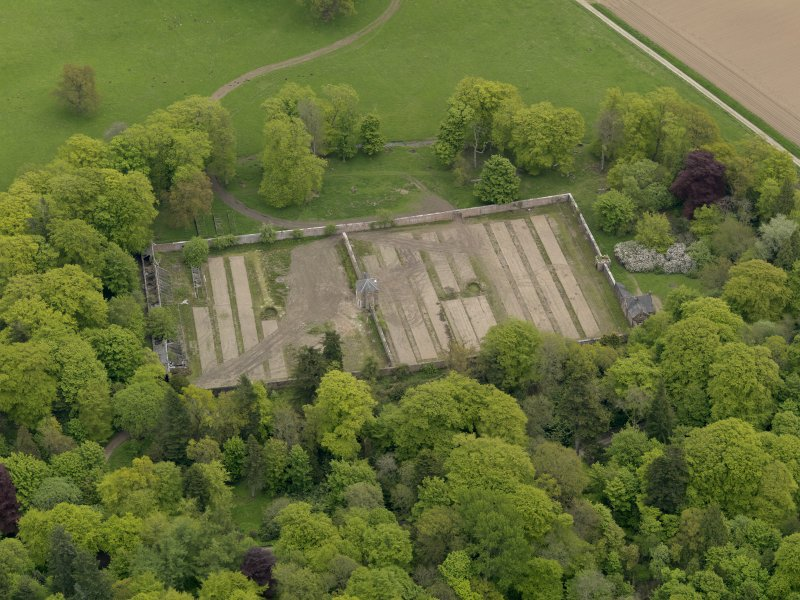 Oblique aerial view centred on the walled garden, taken from the W.