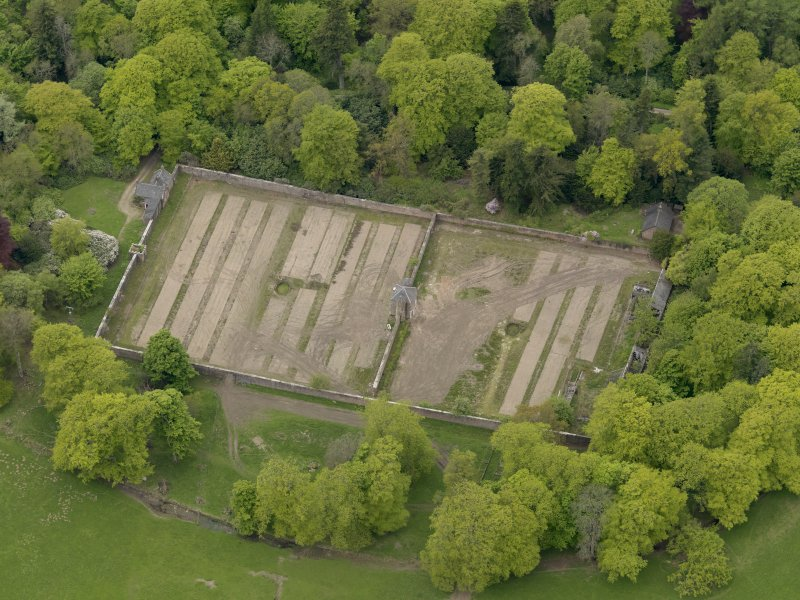 Oblique aerial view centred on the walled garden, taken from the NE.
