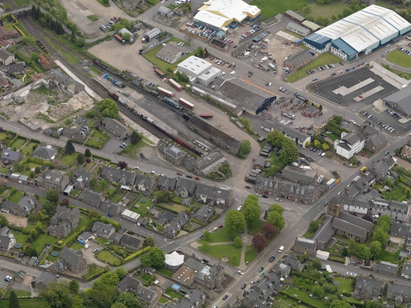 Oblique aerial view centred on the railway terminus, taken from the NW.