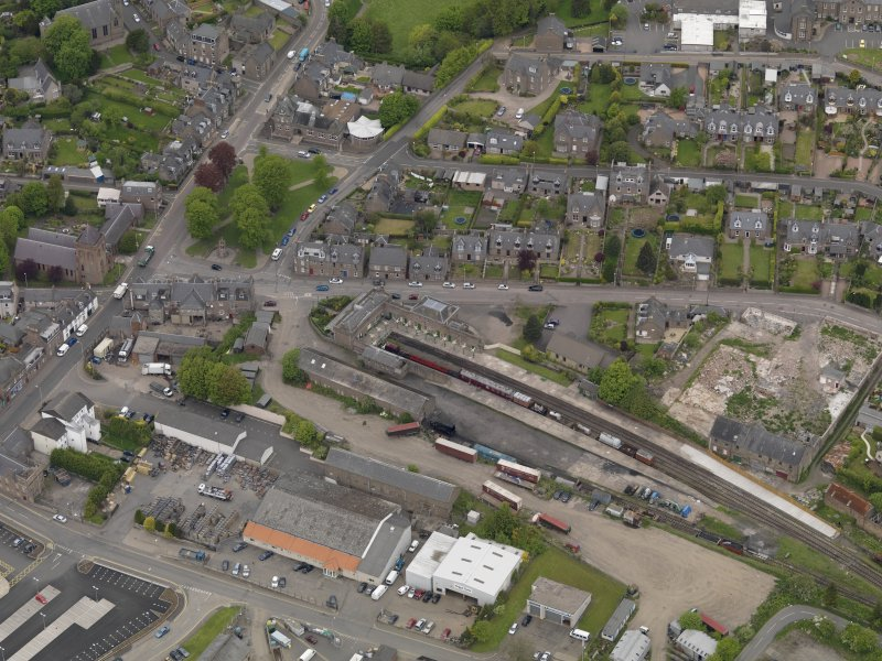 Oblique aerial view centred on the railway terminus, taken from the SE.