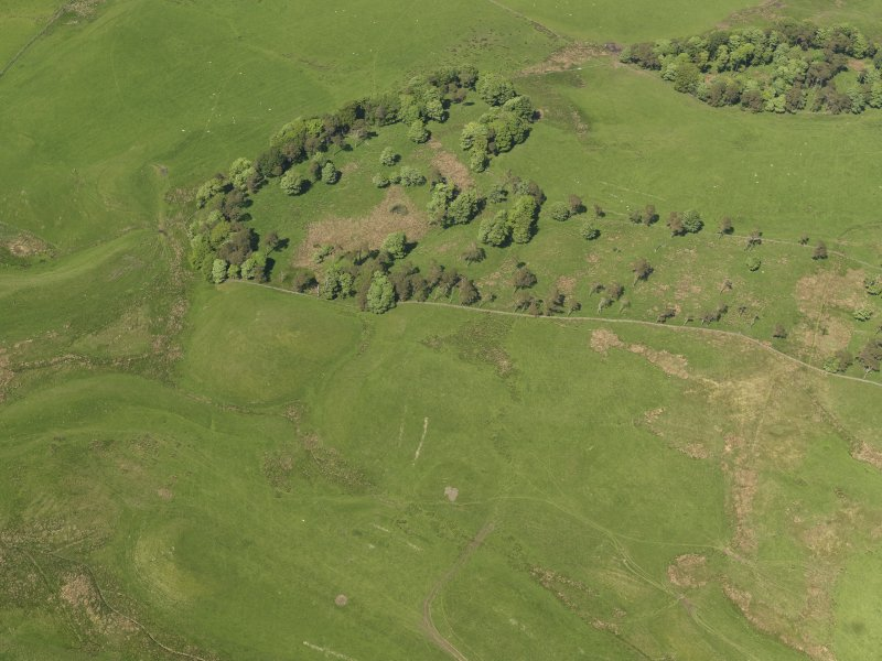 Oblique aerial view centred on the vestigial remains of a Starfish decoy site, taken from the SW.