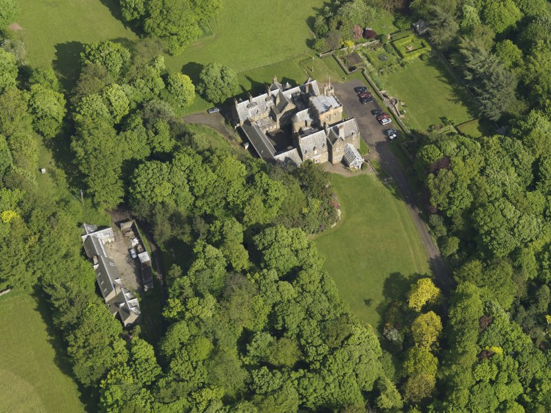 Oblique aerial view centred on the house with the terraced garden adjacent, taken from the WNW.