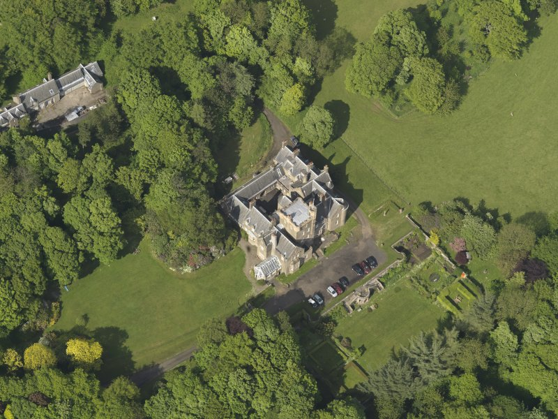 Oblique aerial view centred on the house with the terraced garden adjacent, taken from the WSW.