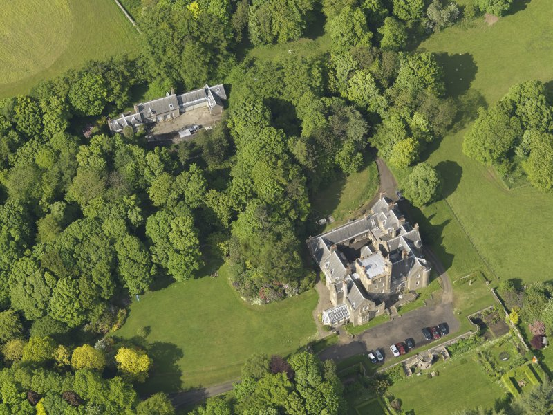 Oblique aerial view centred on the house with the terraced garden adjacent, taken from the SW.