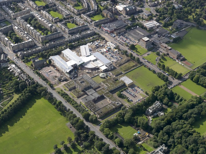 Oblique aerial view centred on Broughton High School and construction site of new school, with Edinburgh City Police HQ to SW, taken from the NNE.
