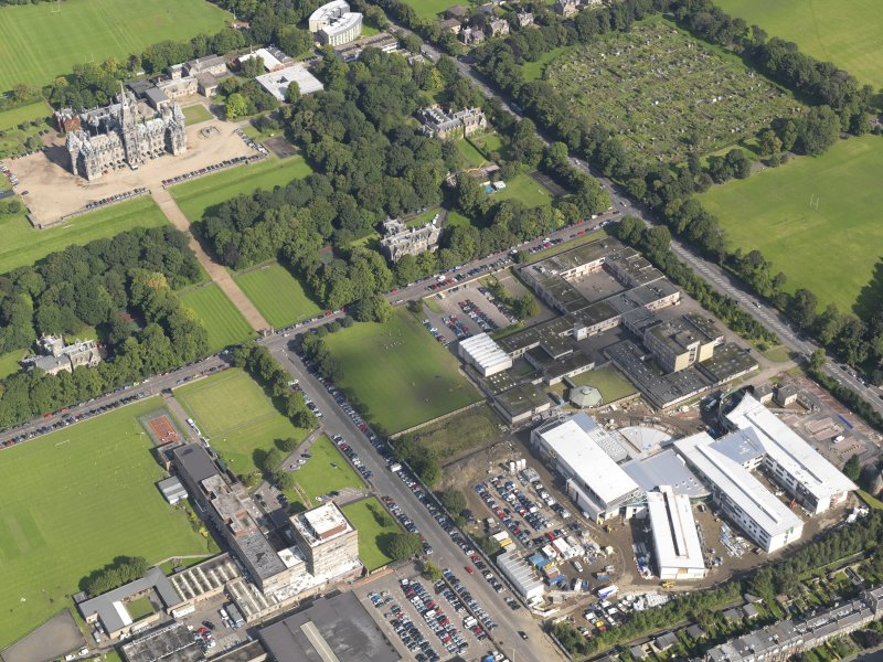 Oblique aerial view centred on Broughton High school and the construction site of the new school with the allotments of Inverleith Park and Fettes College beyond, taken from the SW.