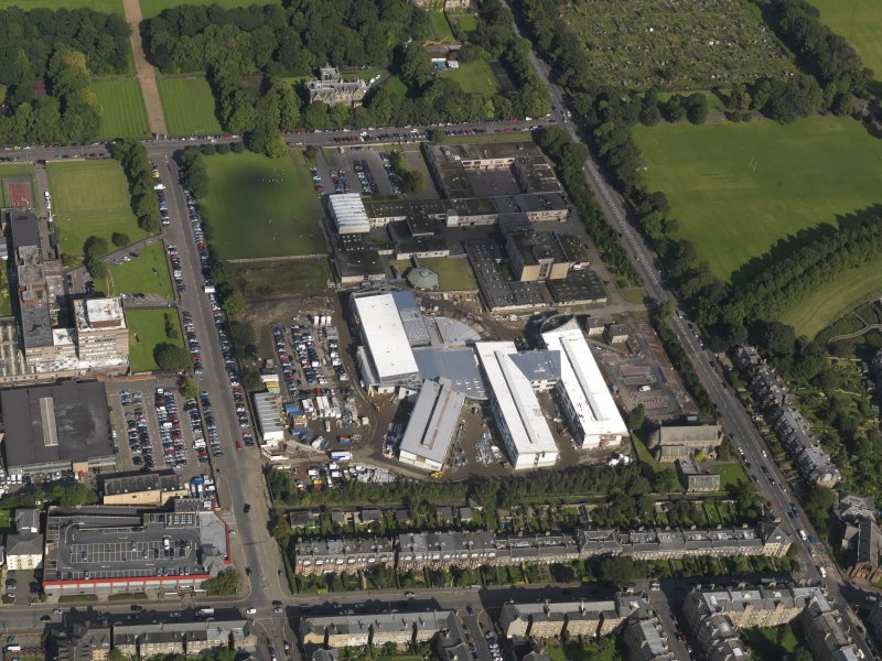 Oblique aerial view centred on Broughton High School and construction site for new school, taken from the SSW.