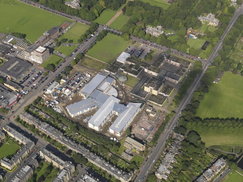 Oblique aerial view centred on Broughton High school and construction site of the new school, taken from the SE.
