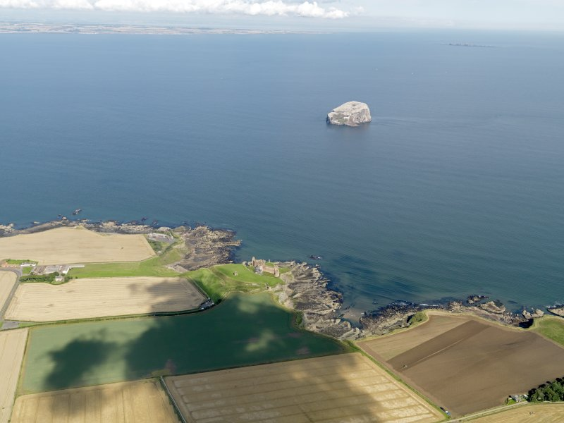 General oblique aerial view looking across Tantallon Castle towards Bass Rock, taken from the SSW.