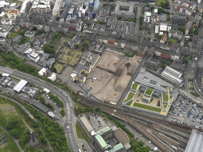 Oblique aerial view centred on the site of redevlopment with the Council Offices adjacent, taken from the NW.