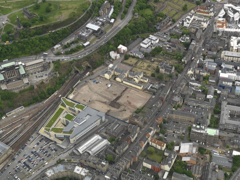 Oblique aerial view centred on the site of redevlopment with the Council Offices adjacent, taken from the WSW.