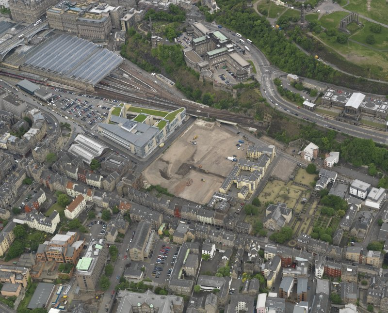 Oblique aerial view centred on the site of redevlopment with the Council Offices adjacent, taken from the SE.