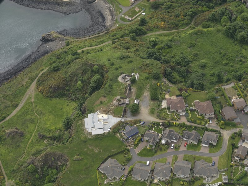 Oblique aerial view centred on the coast battery, taken from the NE.