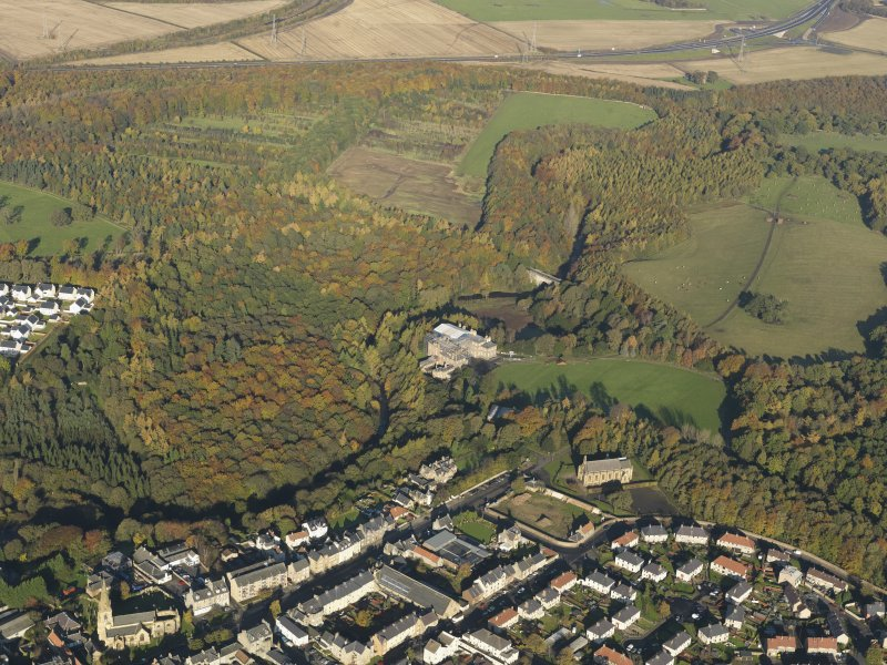 General oblique aerial view centered on Dalkeith Hosue and country park with St Mary's adjacent, taken from the S.