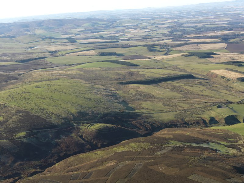 General oblique aerial view of the remains of White Castle fort with the East Lothian coastal plain beyond, taken from the E.