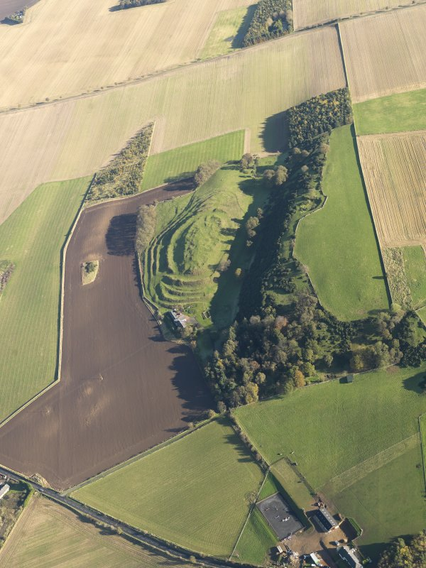 General oblique aerial view of the remains of the fort and settlement at The Chesters, Drem, taken from the WSW.
