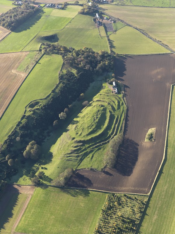 Oblique aerial view of the remains of the fort and settlement at The Chesters, Drem, taken from the ENE.