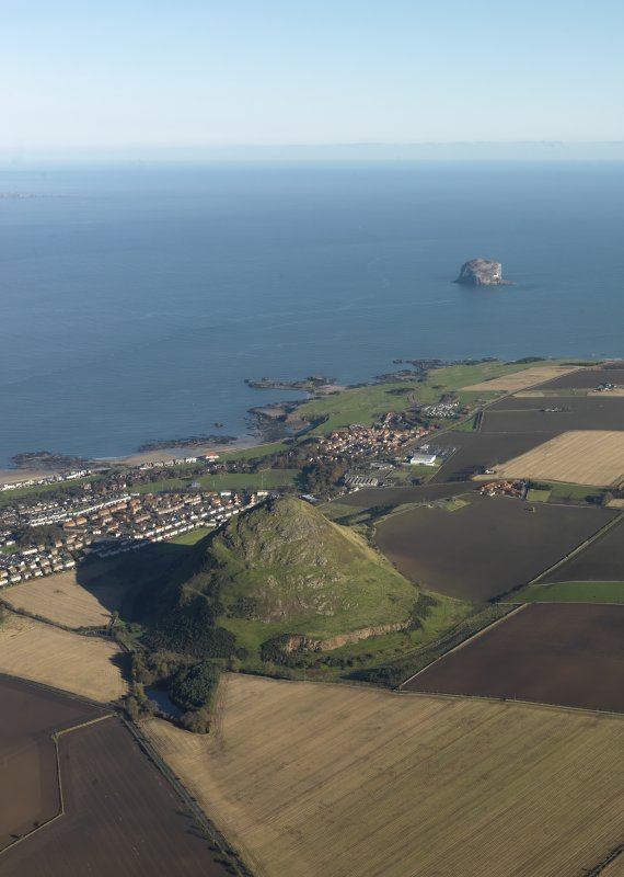 General oblique aerial view of North Berwick Law with North Berwick and the Bass Rock in the background, taken from the SW.