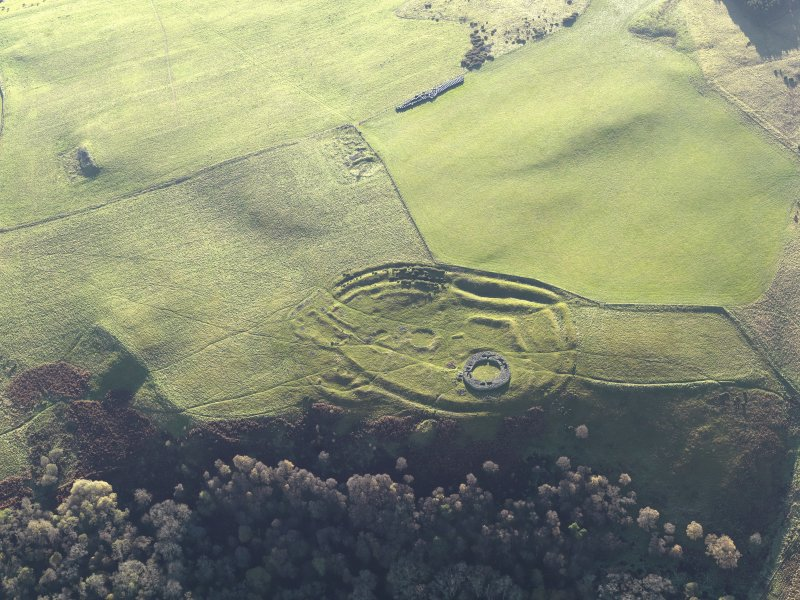 Oblique aerial view of the remains of the fort, settlement and broch at Edin's Hall and the adjacent settlement, taken from the N.