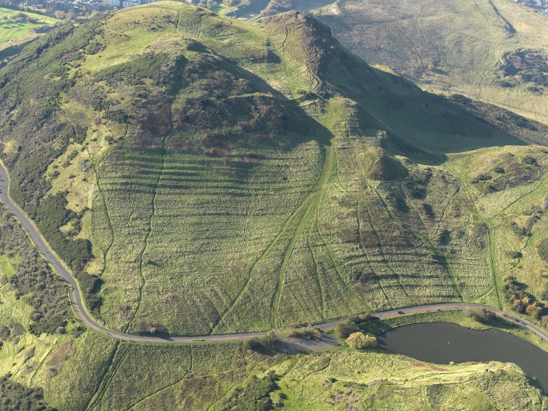 Oblique aerial view of the cultivation terraces and the remains of the fort on Arthur's Seat, taken from the E.