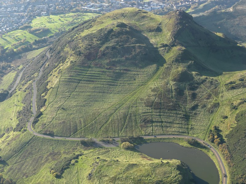 Oblique aerial view of the cultivation terraces and the remains of the fort on Arthur's Seat, taken from the ENE.