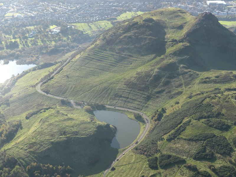 Oblique aerial view of the cultivation terraces and the remains of the fort on Arthur's Seat, taken from the NE.