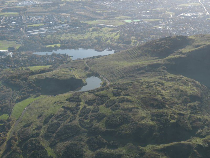 General oblique aerial view of the cultivation terraces and the remains of the fort on Arthur's Seat and Dunsapie, taken from the NE.