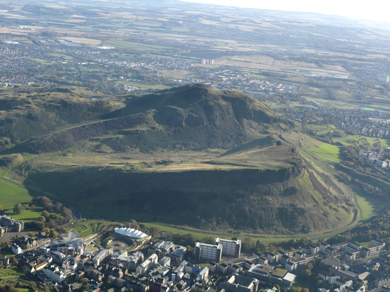 General oblique aerial view looking across Salisbury Crags towards Arthur's Seat, taken from the NW.