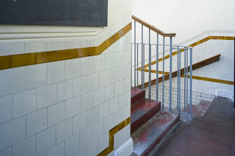 Interior. Ground floor, view of sample stairwell and tiles.