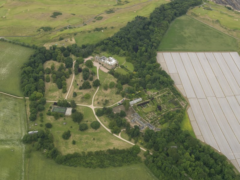 Oblique aerial view centred on Cambo House and its policies, taken from the SSW.