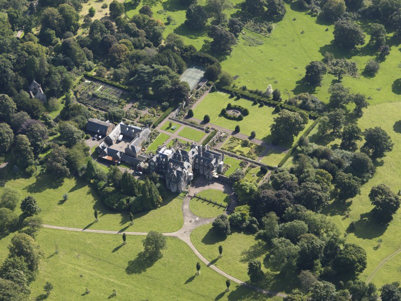 Oblique aerial view centred on the house with the gardens adjacent, taken from the NW.
