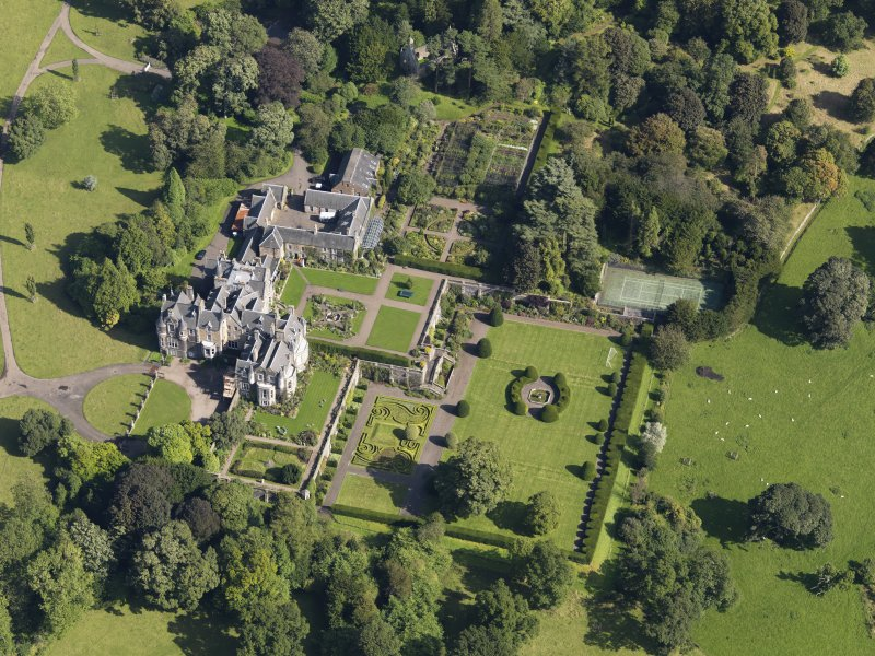 Oblique aerial view centred on the house with the gardens adjacent, taken from the SW.