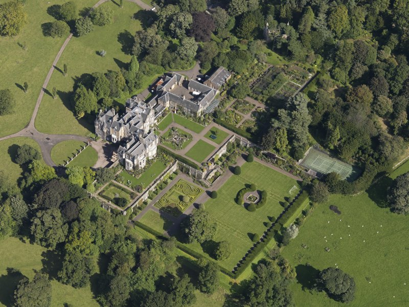 Oblique aerial view centred on the house with the gardens adjacent, taken from the SSW.